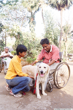 Therapy dog Angel and Rohini Fernandes work with a physically challenged client to help improve fine and gross motor skills